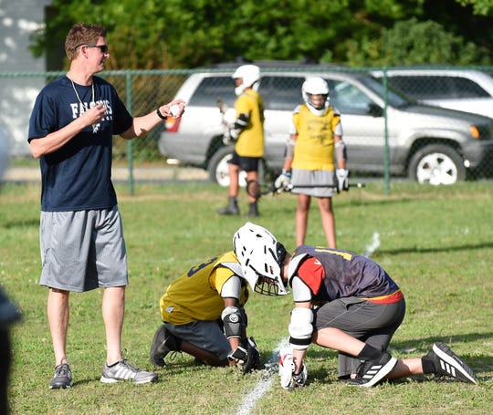 Fruitland Falcons coach Joe Monar sets up the face off during the first-ever home lacrosse game at the Doverdale Playground on Wednesday, Jun. 12, 2019.