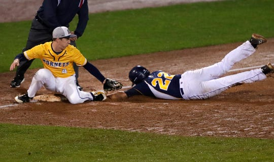 Ozaukee's Matt Miller is safe at third base after Markesan's Craig Plagenz drops the ball during the WIAA baseball state tournament Division 3 semifinal Wednesday, June 12, 2019 at Neuroscience Group Field at Fox Cities Stadium in Grand Chute, Wis. Danny Damiani/USA TODAY NETWORK-Wisconsin