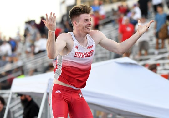 Chris Nilsen of South Dakota celebrates after winning the pole vault in a meet-record 19-6 1/4 (5.95m) during the NCAA Track & Field Championships at Mike A. Myers Stadium.