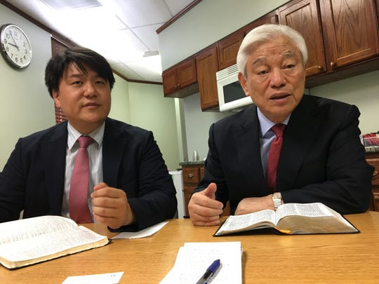 Accompanied by a translator (left), Pastor Ock Soo Park, with Good News Mission, talks about his hopes for Mahanaim Bible Training Center, now operating on the campus of the former Central Bible College in north Springfield, on Thursday, June 13, 2019.