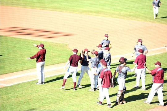 Stuarts Draft players congratulate Aric Gutt on a run he scored in the third inning of Thursday's VHSL Class 2 baseball state semifinal.