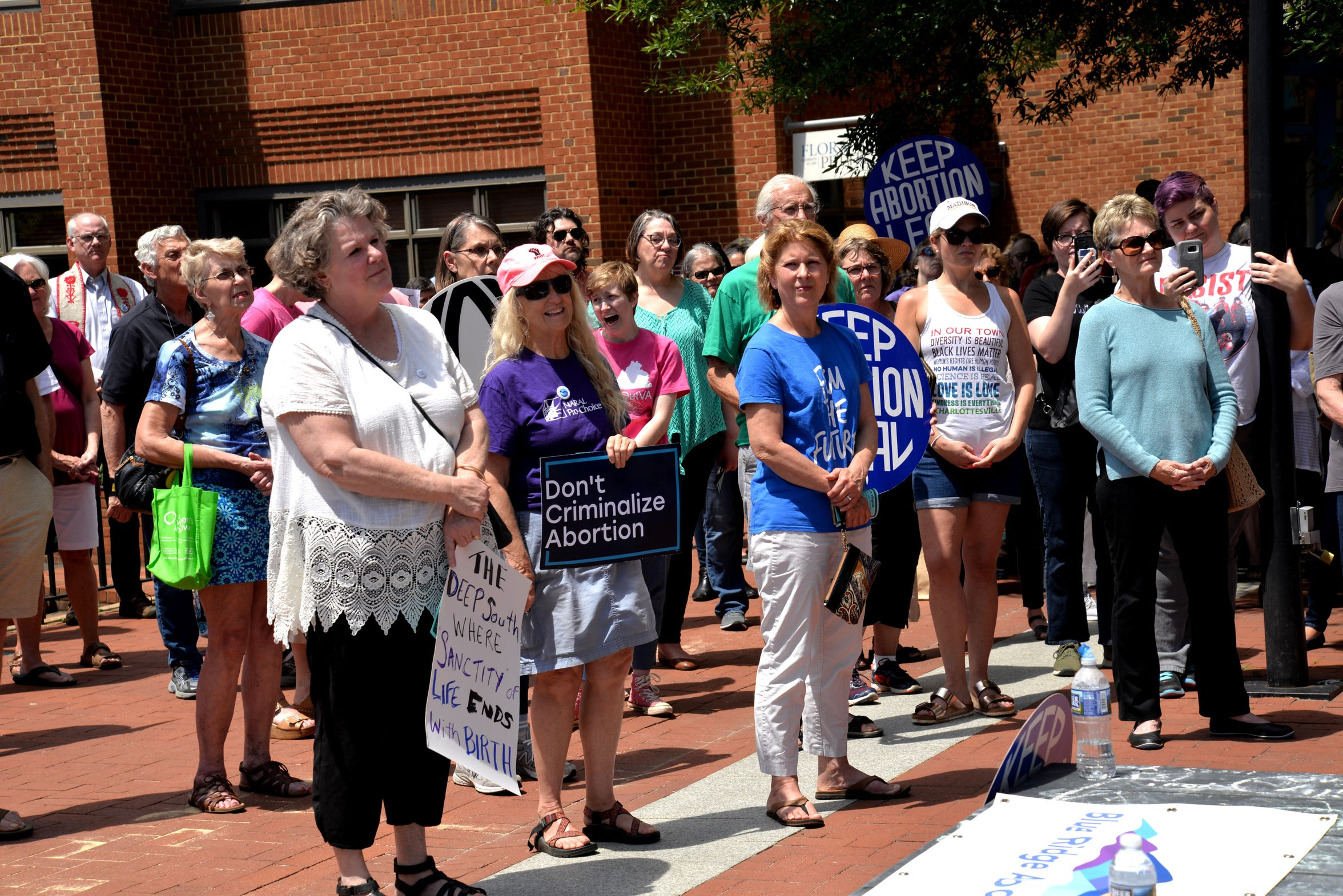 People gather on the downtown walking mall in Charlottesville on May 21, 2019 for an abortion access rally organized by the Blue Ridge Abortion Fund and Charlottesville National Organization of Women.