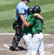 Levi Bast and Zach Schroeder congratulate each other after scoring runs in the third inning of Paynesville's 3-2 win in the Class AA State Quarterfinals, Thursday, June 13 at Dick Putz Field.