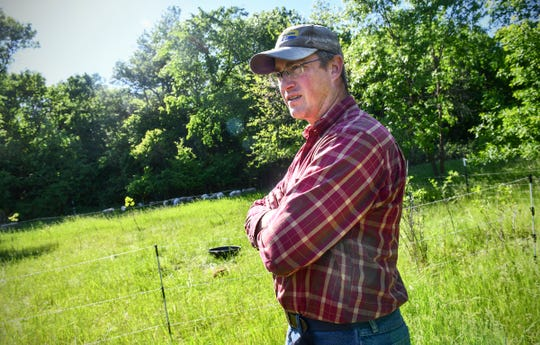 Colin King talks about methods he uses Wednesday, June 12, at his farm near Long Prairie.