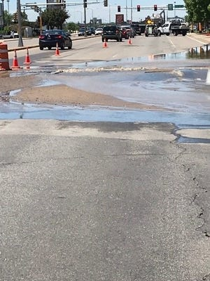 A water main break in the westbound lanes of Minnesota Highway 23 is pictured Thursday, June 13 in Waite Park.