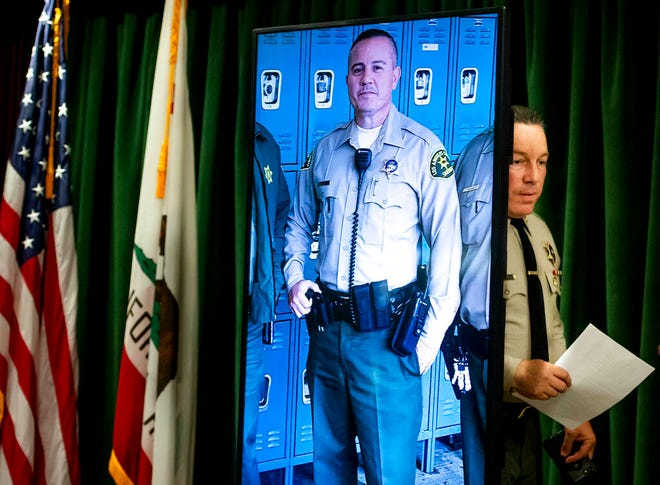 Los Angeles County Sheriff Alex Villanueva arrives to a news conference in Los Angeles on Tuesday, June 11, 2019. Rhett Nelson, 30, of St. George, Utah, was arrested Tuesday on suspicion of shooting an off-duty Los Angeles County sheriff's deputy at a fast-food restaurant Monday, and authorities say they are investigating whether he may have killed another man an hour earlier in attacks that both appear to be random. (Sarah Reingewirtz/The Orange County Register via AP)