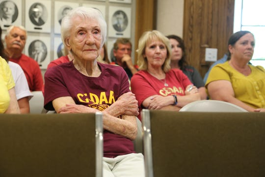 "Supporters of a proposal to turn a Cedar City water tank with artwork of the former Cedar High mascot, the ""Redman,"" attend a city council meeting on June 12."