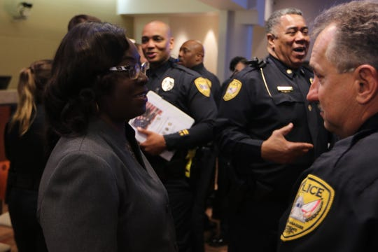 Maj. Steve Outlaw, far right, speaks with City Commissioner Diane Williams-Cox during a TPD swearing in ceremony