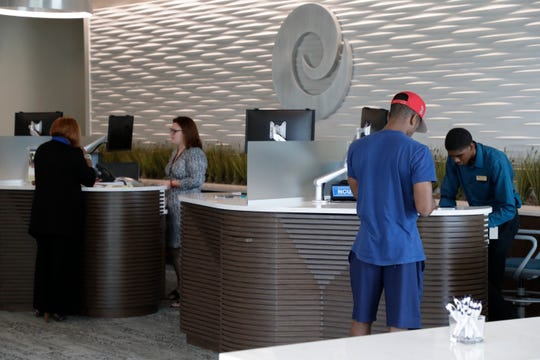 Tellers Kathryn Hicks and Tyon Parker help customers at Envision Credit Union's new two-story, 10,000 square-foot, full-service financial center at 600 N. Monroe Street Thursday, June 13, 2019.