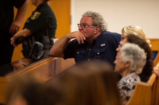 Dr. Wade Harrouff, father of Austin Harrouff, listens in on a hearing regarding his son Thursday, June 13, 2019, at the Martin County Courthouse in Stuart.