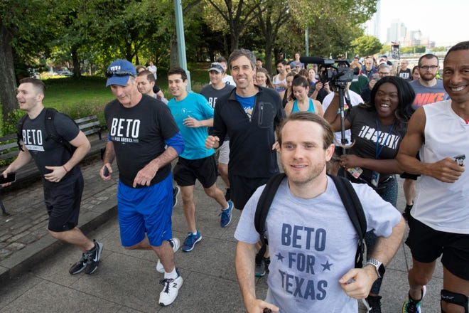 Democratic presidential candidate Beto O'Rourke, second row center, participates in a 2-mile run with members and friends of the LGBTQ community Wednesday, June 12, 2019, in New York.