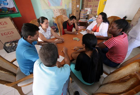 A visiting psychologist holds a group therapy session at El Buen Pastor migrant shelter in Juarez Thursday.