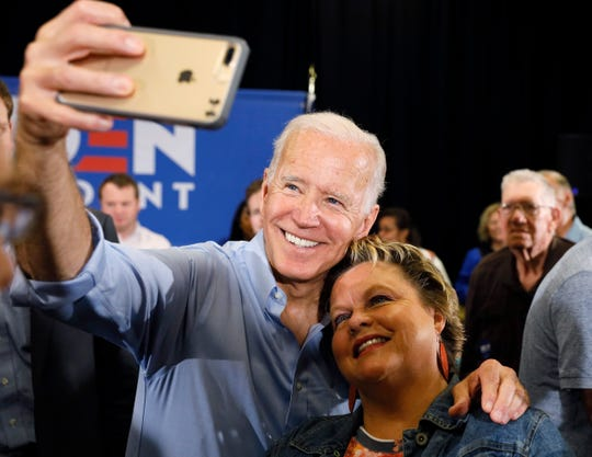 Democratic presidential candidate former Vice President Joe Biden poses for a photo with an audience member after speaking at Clinton Community College, on Wednesday, June 12, 2019, in Clinton, Iowa.