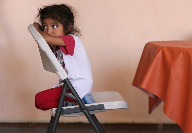 A young migrant from Guatemala watches anxiously as dinner is cooked at El Buen Pastor migrant shelter in Juarez.