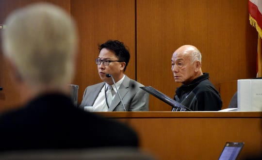 Huy Fong Foods CEO David Tran, right, takes the witness stand along with interpreter Michael Hong on Thursday in the civil trial between the Sriracha maker and Ventura County grower Underwood Ranches.