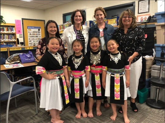 Rothschild Elementary School students performed a retirement dance to honor Assistant Superintendent Mary Jo Lechner, back row, second from left, upon her retirement.