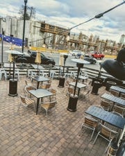 The outdoor space at Smokehouse Tailgate Grill in New Rochelle looks out to its possible new space across the street.