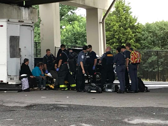 New Castle County Paramedics arrived underneath the Maryland Avenue I-95 overpass Thursday when friends of a homeless man reported he was having seizures. His friends believe he was suffering from alcohol withdrawals.