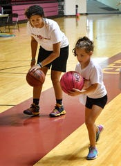 Kityana Diaz coaches a camper in the Midwestern State University Women's Basketball Basic Skills Camp Thursday morning at Ligon Coliseum.