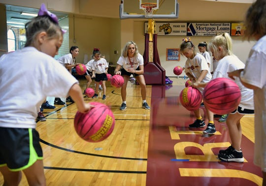 Courtney Kerr teaches girls ball handling in the Midwestern State University Women's Basketball Basic Skills Camp Thursday morning at Ligon Coliseum.