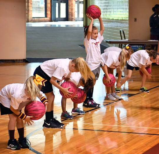 Girls in the Midwestern State University Women's Basketball Basic Skills Camp had fun while learning passing, dribbling and shooting.