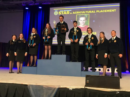 Denmark FFA Chapter member Jeremy Schlies is the Wisconsin Star in Agricultural Placement, He is joined on the podium (from left) by Katelyn Loehrke fourth place finisher, Abbygail Hayes, runner up, Kyle Propson third place finisher and Lucas Miller, fifth place finisher.