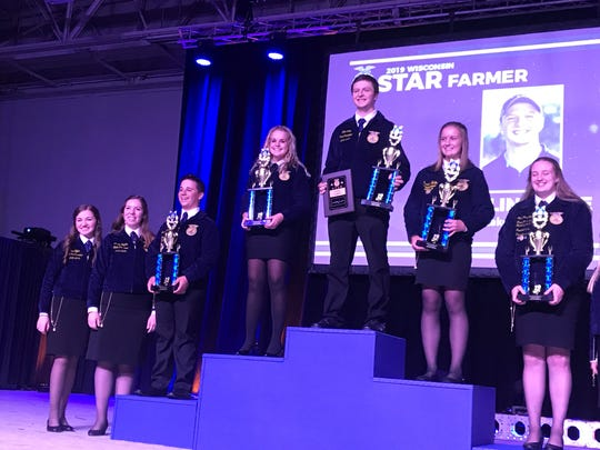 Collin Wille of Rice Lake was named the 2019 Wisconsin Star Farmer. He is joined by (from left) fourth place finisher Kevin Kitchen, runner-up Hailey Hendrickson,, third place finisher Brooke Welke and fifth place finsiher Jacquelyn Rosenbush.