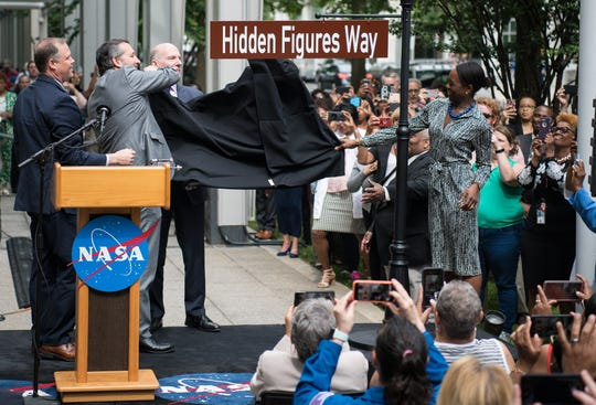 "NASA Administrator Jim Bridenstine, left, U.S. Sen. Ted Cruz, R-Texas, D.C. Council Chairman Phil Mendelson, and Margot Lee Shetterly, author of the book ""Hidden Figures,"" unveil the ""Hidden Figures Way"" street sign at a dedication ceremony, Wednesday, June 12, 2019, at NASA headquarters in Washington, D.C. The designation honors Katherine Johnson, Dorothy Vaughan, Mary Jackson and all women who have dedicated their lives to contributing to the space program of the United States."