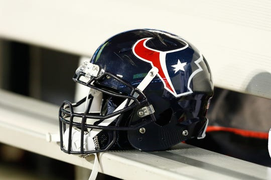 Texans helmet lays on the bench during the game.