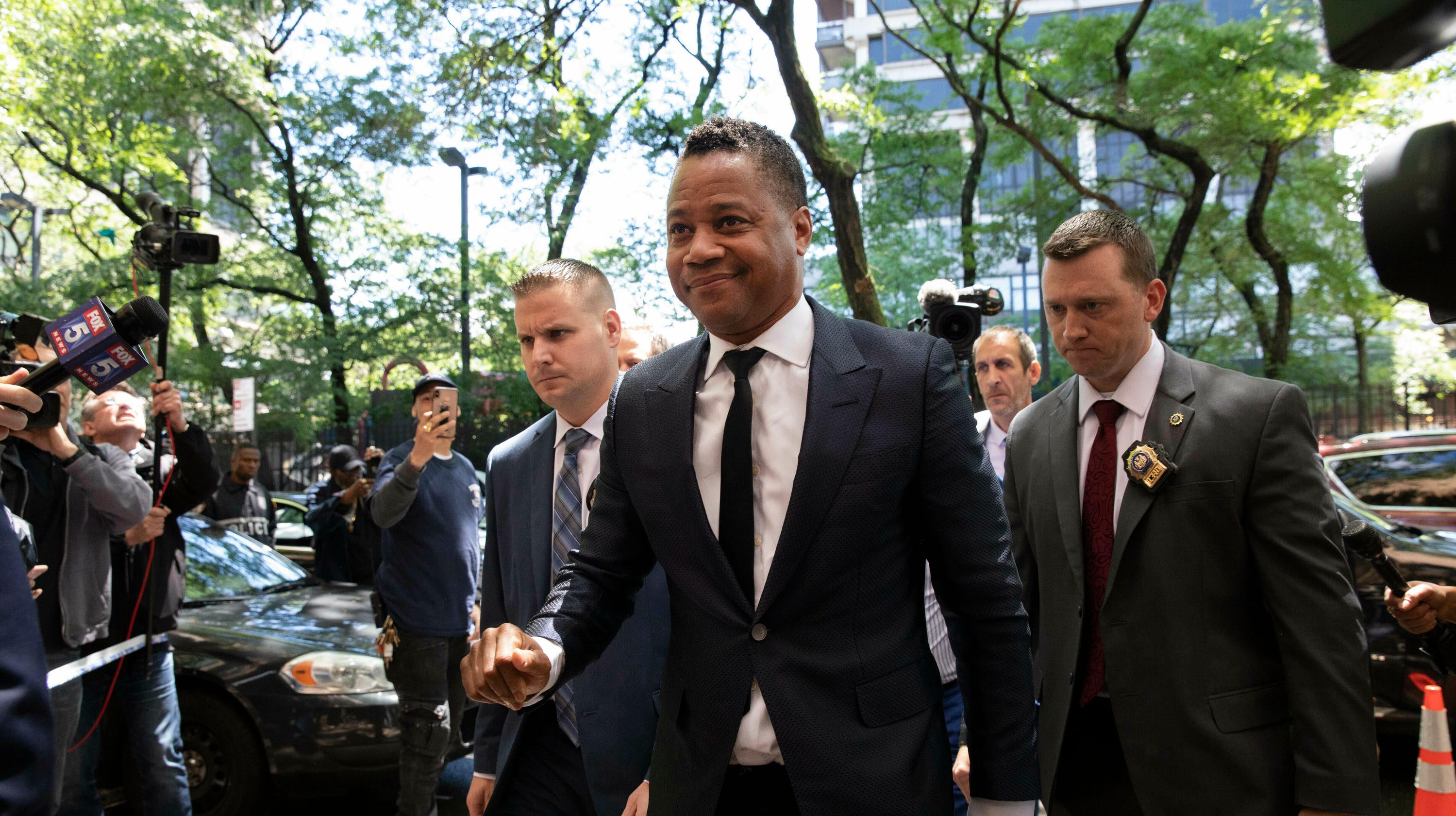 Cuba Gooding Jr. surrenders to NYPD on groping allegation, charged with 'forcible touching'