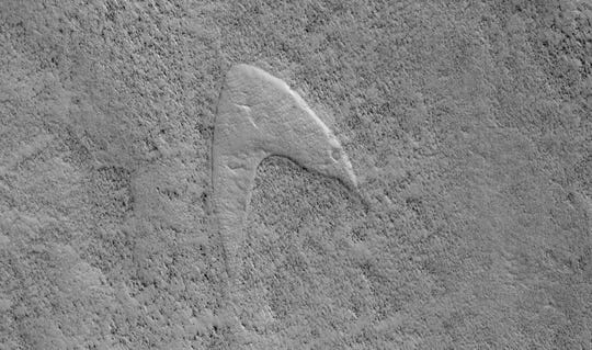 A shape on the Martian surface -- which looks remarkably like the logo from Star Trek -- was created by a combination of wind, sand and lava.