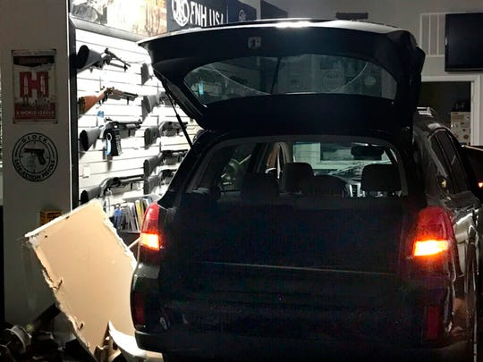 This photo provided by Montgomery County Police show a vehicle that was used to smash into a Rockville gun shop early Thursday, June 13, 2019 in Rockville, Md. Police responding to a burglary say one person is dead and four others are at large and