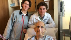 Philip Ayoub, 58, an accountant and former comptroller for the National Football League, with his twin sons. Heart disease, which ran in his family, hit him early: He had his first coronary bypass surgery at age 30 and his second at 43. (Courtesy of Karen Ayoub)