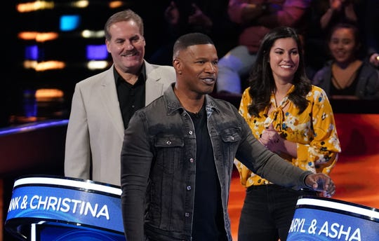 "Jamie Foxx with contestants on ""Beat Shazam."""