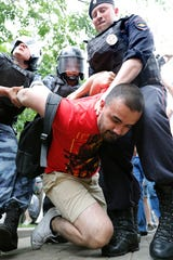 Russian riot police detain a participant of a protest action supporting arrested and now released Meduza's journalist Ivan Golunov suspected in drug keeping and spreading in Moscow, Russia, 12 June 2019. Ivan Golunov, a journalist specialized in corruption cases investigations was arrested by police for drug spreading and later released after a wave of public protests. I