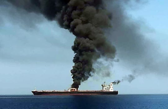 Smoke billows from a tanker off the coast of Oman on June 13.