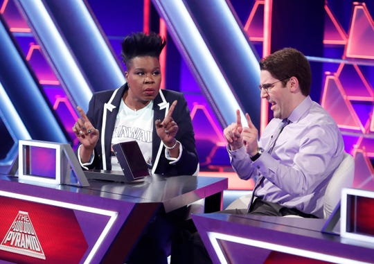 """Leslie Jones and a contestant on """"The 100,000 Pyramid."""""""