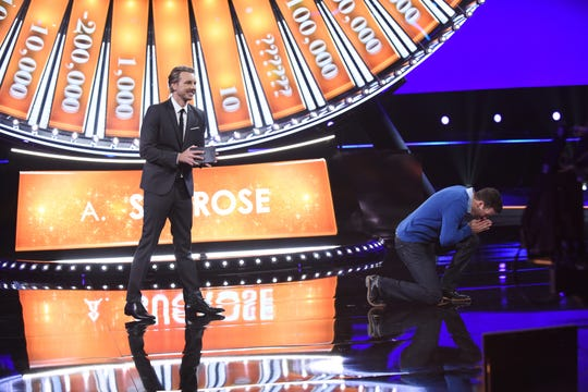 """Host Dax Shepard and contestant Daniel Konzelman in """"Spin the Wheel."""""""