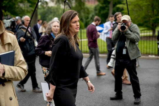 Former White House press secretary Sarah Huckabee Sanders walks into the West Wing of the White House after speaking members of the media on May 16 in Washington, D.C.