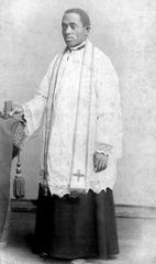 This 1886 photo courtesy of the Brenner Library, Quincy University in Quincy, Ill., shows Quincy's Father Augustine Tolton, following his ordination on Holy Saturday of that year.
