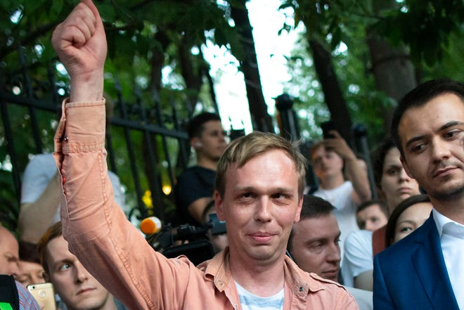 Prominent Russian investigative journalist Ivan Golunov, greets colleagues and his supporters as he leaves a Investigative Committee building in Moscow, Russia, Tuesday, June 11, 2019. In a surprising turnaround, Russia's police chief on Tuesday dropped all charges against a prominent investigative reporter whose detention sparked public outrage and promised to go after the police officers who tried to frame the journalist as a drug-dealer.