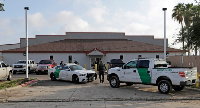 In this Saturday, June 23, 2018, file photo, a U.S. Border Patrol Agent walks between vehicles outside the Central Processing Center in McAllen, Texas. Advocates were shocked to find an underage mom and her tiny, premature newborn daughter huddled in a Border Patrol facility the second week of June 2019, in what they say was another example of the poor treatment immigrant families receive after crossing the border.