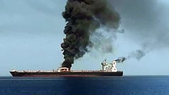 "A picture obtained by AFP from Iranian State TV IRIB on June 13, 2019 reportedly shows smoke billowing from a tanker said to have been attacked off the coast of Oman, at un undisclosed location. The crews of two oil tankers were evacuated off the coast of Iran today after they were reportedly attacked and caught fire in the Gulf of Oman, sending world oil prices soaring. The mystery incident, the second involving shipping in the strategic sea lane in only a few weeks, came amid spiralling tensions between Tehran and Washington, which has pointed the finger at Iran over tanker attacks in May. Iran said its navy had rescued 44 crew members after the two vessels caught fire in ""accidents"" off its coast. (Photo by HO / IRIB TV / AFP) / == RESTRICTED TO EDITORIAL USE - MANDATORY CREDIT ""AFP PHOTO / HO / IRIB"" - NO MARKETING NO ADVERTISING CAMPAIGNS - DISTRIBUTED AS A SERVICE TO CLIENTS FROM ALTERNATIVE SOURCES, AFP IS NOT RESPONSIBLE FOR ANY DIGITAL ALTERATIONS TO THE PICTURE'S EDITORIAL CONTENT, DATE AND LOCATION WHICH CANNOT BE INDEPENDENTLY VERIFIED - NO RESALE -NO ACCESS lSRAEL MEDIA -PERSIAN LANGUAGE TV STATIONS OUTSIDE IRAN - STRICTLY NO ACCESS BBC PERSIAN == / HO/AFP/Getty Images ORIG FILE ID: AFP_1HH1VD"