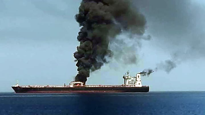 """A picture obtained by AFP from Iranian State TV IRIB on June 13, 2019 reportedly shows smoke billowing from a tanker said to have been attacked off the coast of Oman, at un undisclosed location. The crews of two oil tankers were evacuated off the coast of Iran today after they were reportedly attacked and caught fire in the Gulf of Oman, sending world oil prices soaring. The mystery incident, the second involving shipping in the strategic sea lane in only a few weeks, came amid spiralling tensions between Tehran and Washington, which has pointed the finger at Iran over tanker attacks in May. Iran said its navy had rescued 44 crew members after the two vessels caught fire in """"accidents"""" off its coast. (Photo by HO / IRIB TV / AFP) / == RESTRICTED TO EDITORIAL USE - MANDATORY CREDIT """"AFP PHOTO / HO / IRIB"""" - NO MARKETING NO ADVERTISING CAMPAIGNS - DISTRIBUTED AS A SERVICE TO CLIENTS FROM ALTERNATIVE SOURCES, AFP IS NOT RESPONSIBLE FOR ANY DIGITAL ALTERATIONS TO THE PICTURE'S EDITORIAL CONTENT, DATE AND LOCATION WHICH CANNOT BE INDEPENDENTLY VERIFIED - NO RESALE -NO ACCESS lSRAEL MEDIA -PERSIAN LANGUAGE TV STATIONS OUTSIDE IRAN - STRICTLY NO ACCESS BBC PERSIAN  == / HO/AFP/Getty Images ORIG FILE ID: AFP_1HH1VD"""
