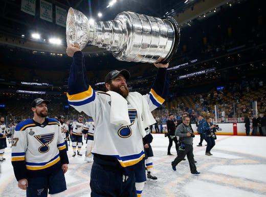 4ec0d7a5133 Game 7: St. Louis Blues defenseman Alex Pietrangelo hoists the Stanley Cup  after his