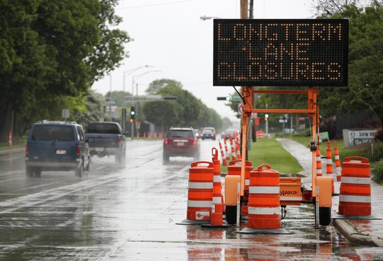 A sign alerts motorist about long-term lane closures on East Calumet Street.
