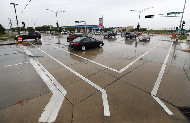 Traffic moves through the intersection of Kensington Drive and East Calumet Street on Friday.