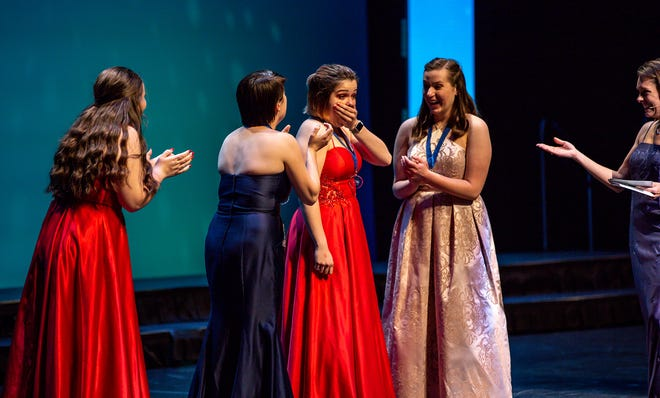 Kyra Hietpas, center, reacts to winning the outstanding actress category at the Center Stage High School Musical Theater Awards in May at the Fox Cities Performing Arts Center in Appleton.