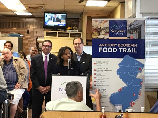 Assemblyman Paul Moriarty (D-Gloucester); New Jersey Secretary of State Tahesha Way; and  Executive Director of the New Jersey Division of Travel and Tourism Jeffrey Vasser at Frank's Deli in Asbury Park on June 13, 2019 to celebrate the Anthony Bourdain Food Trail.
