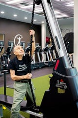 Tinton Falls Mayor Vito Perillo tries out the exercise equipment at Soul Focus in Eatontown.